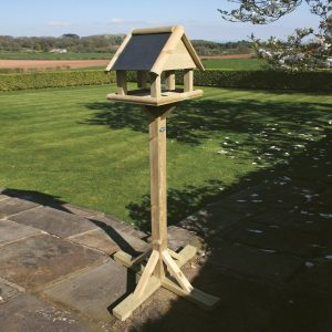 Wooden bird table with feeder